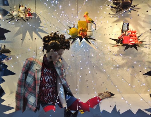 Luxury designer brands in festive store window