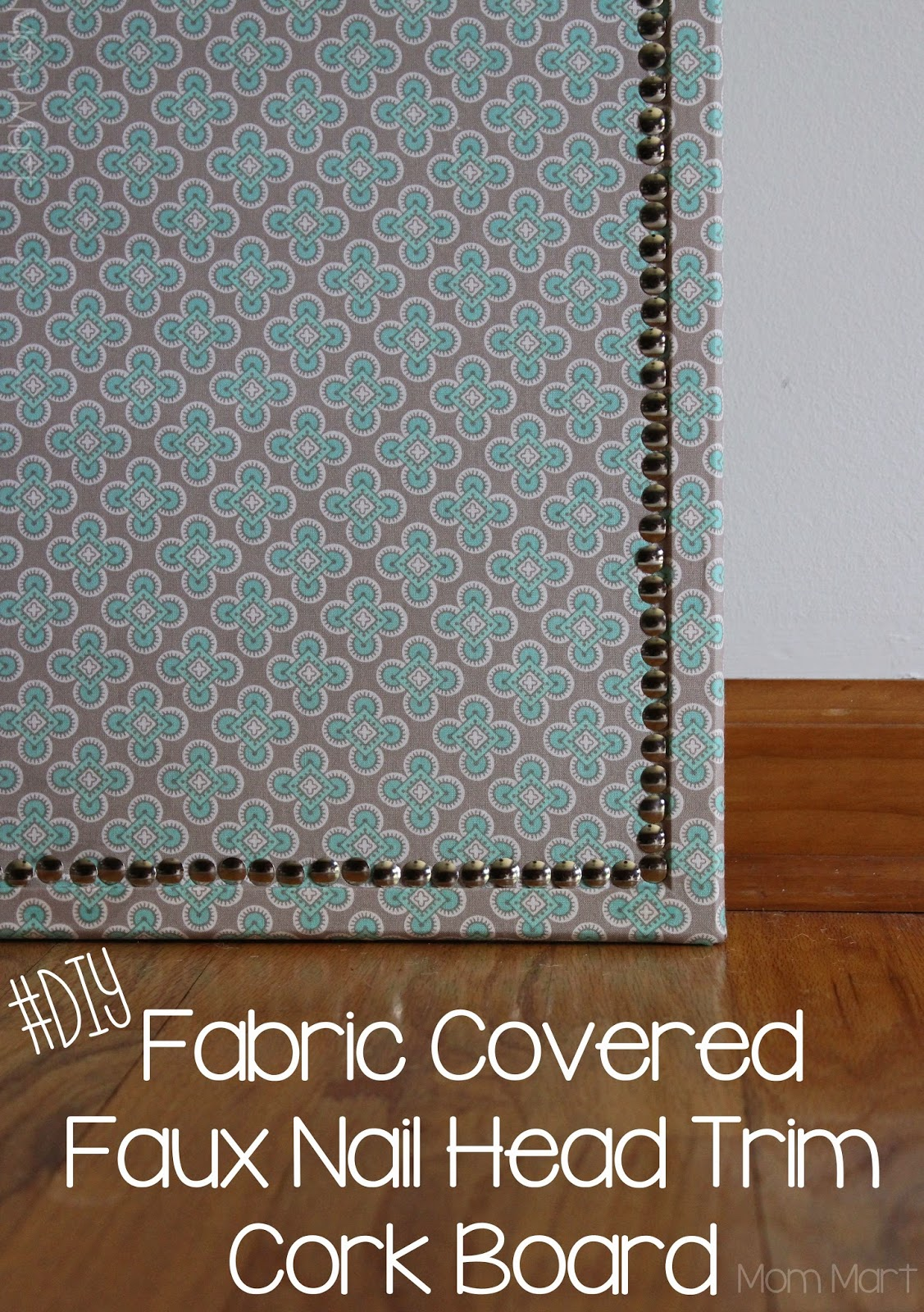 DIY fabric covered cork board with a faux nail head trim #DIY #HomeDecor