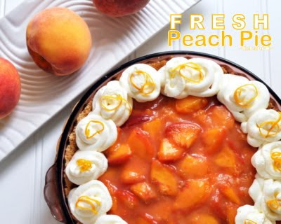 Fresh Peach Pie, luscious summer pie, fresh peaches in light orange sauce, topped with whipped cream. © Kitchen Parade.