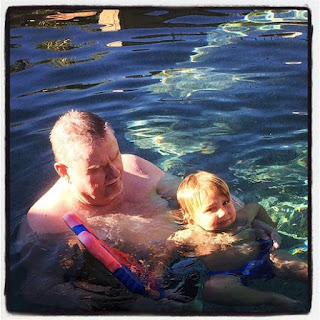 Opa and Reef relax in the pool.