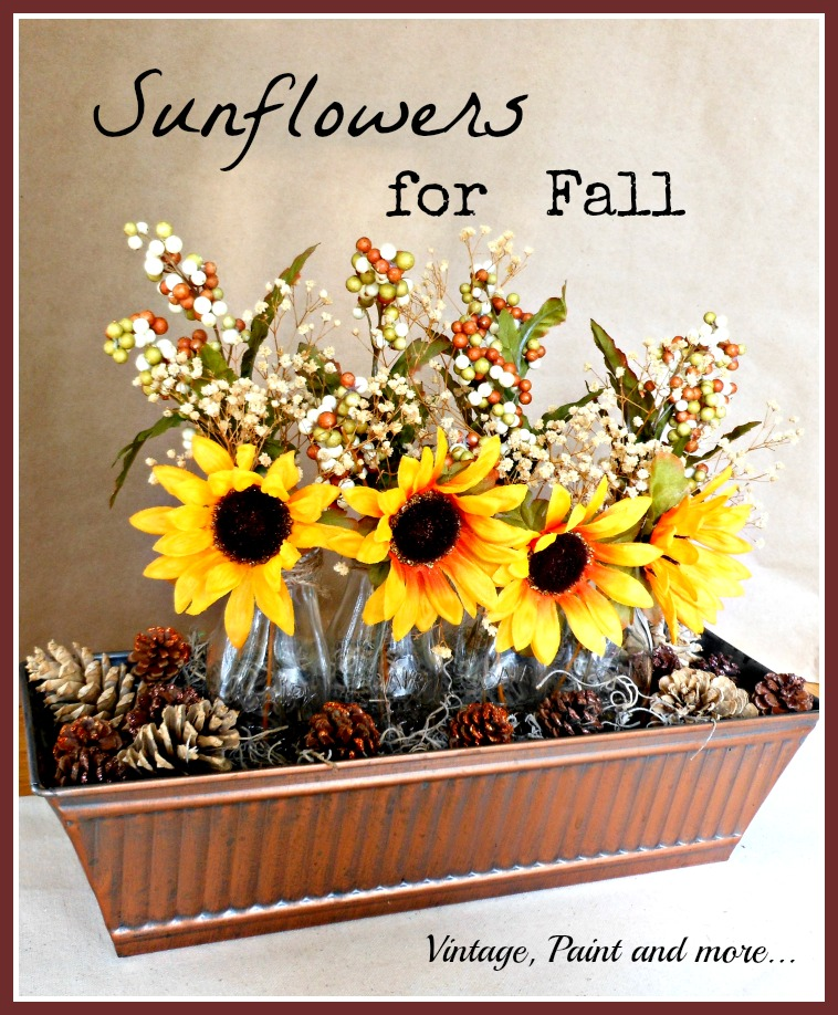 Vintage, Paint and more... vintage bronze trough with sunflowers in milk bottles and pinecones, twine wrapped pears