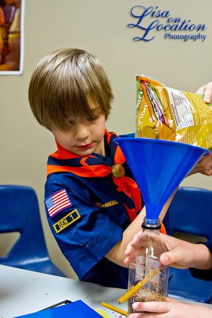 Cub Scout making bird feeder, 365