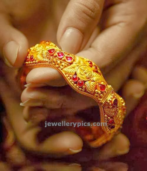 temple gold bangle with lakshmi devi design