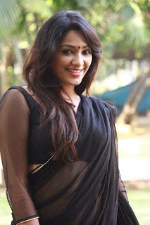 Actress Samruthika  Picture Gallery in Black Saree at Aayirathil Iruvar Movie Press Meet CelebsNext 3.JPG