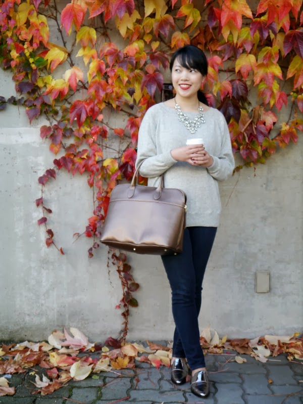 Grey J. Crew cashmere sweater worn with sparkly J. Crew statement necklace, dark wash skinny jeans, 3.1 Phillip Lim silver metallic loafers, a custom gold saffiano leather bag from Roots, and red Dior lipstick.