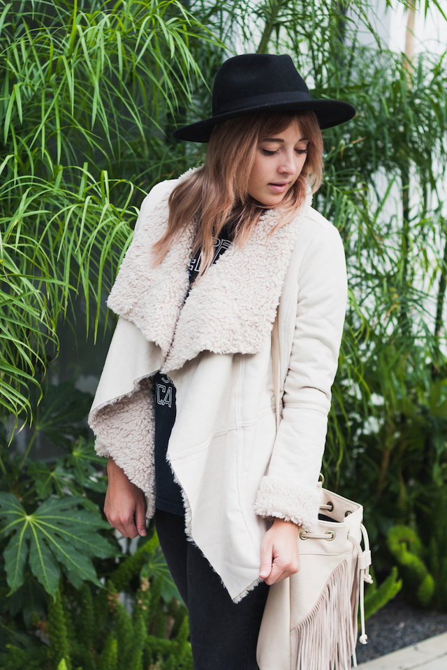 Shearling Jacket and fringe accessories with an oversized wide brim fedora worn for a bohemian edgy outfit on San Francisco fashion blogger Bryn Newman of Stone Fox Style