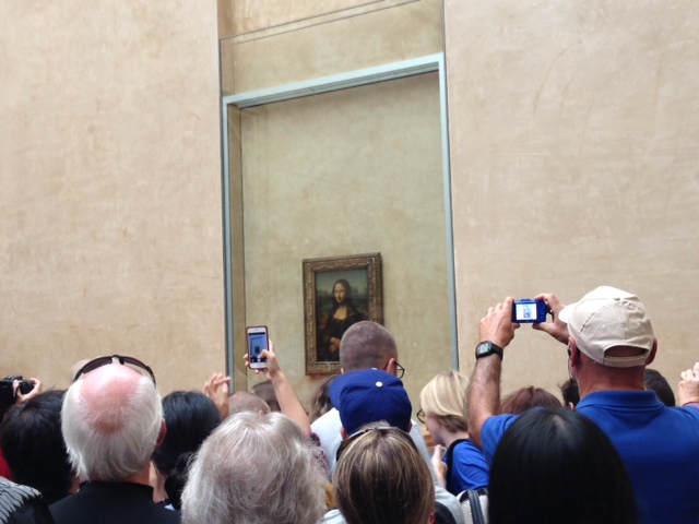 A Crowd surrounds the Mona Lisa at the Louvre
