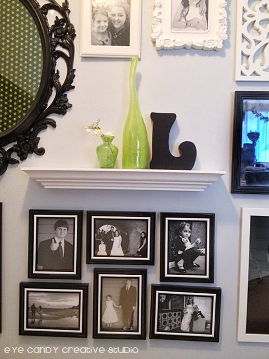 hanging photos on photo gallery, black and white photos, IKEA frames, white shelf