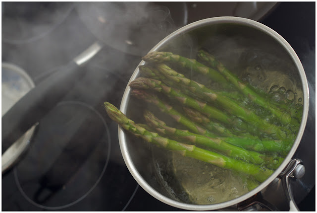 A photograph of Asparagus being blanched