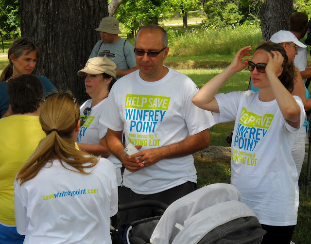 Supporters of Save Winfrey Point gather to protest at White Rock Lake, Dallas