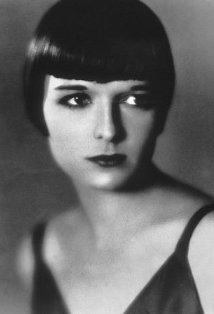 Vintage black and white photo of actress Louise Brooks with a short bob haircut and dark lipstick.