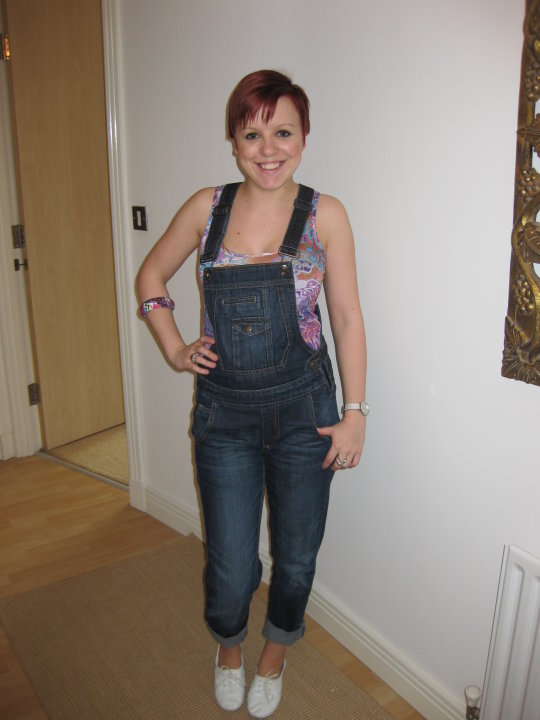 Half naked girl in overalls