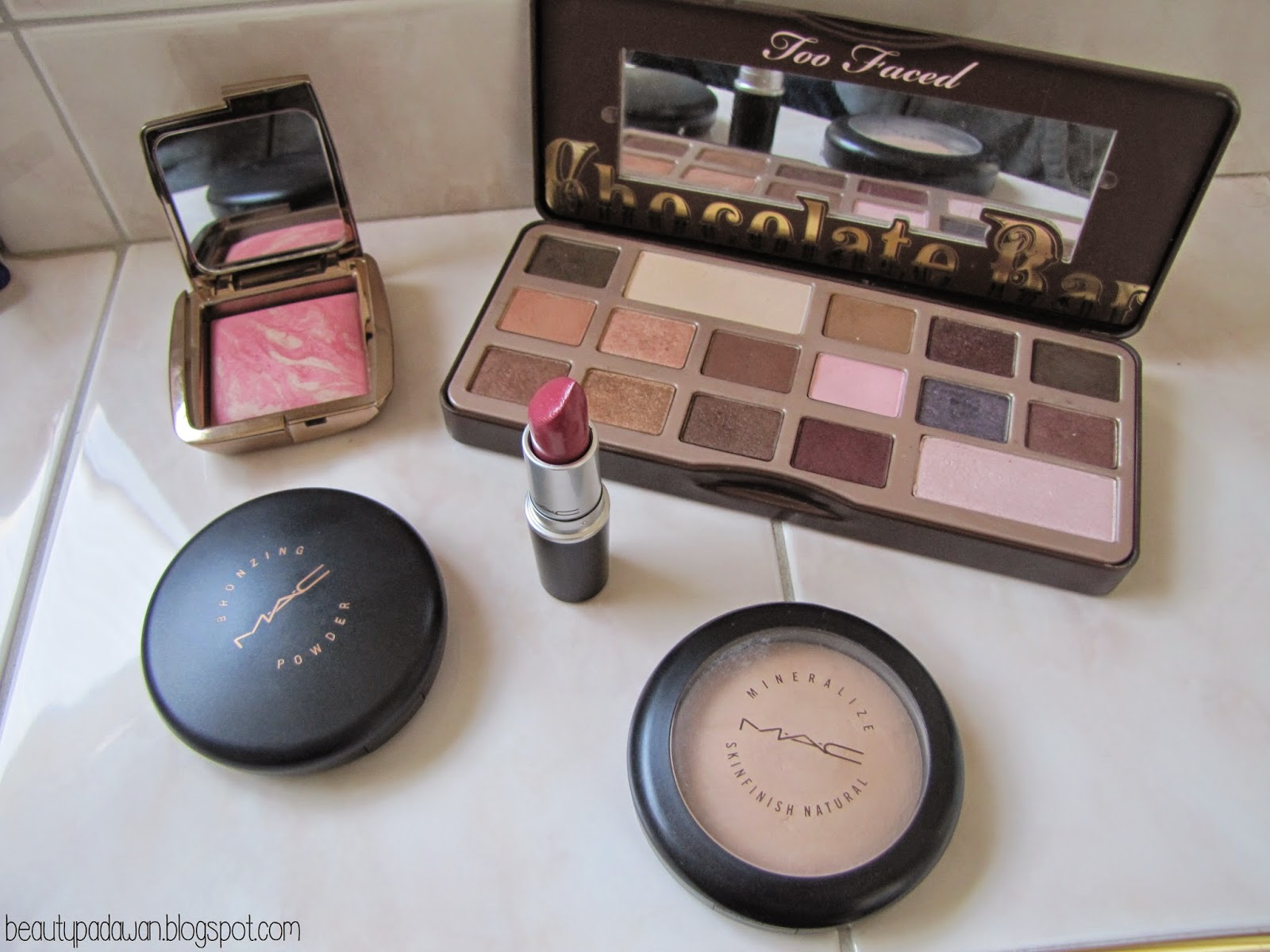 Too Faced Chocolate Bar Palette; Hourglass Ambient Lighting Blush; MAC Bronzing Powder; MAC Novel Romance Lipstick - Yield to Love; MAC Mineralize SkinFinish
