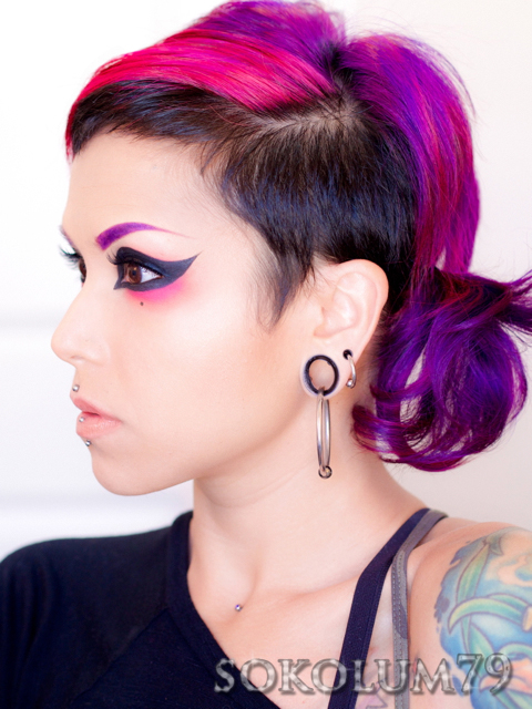 Extreme cat eye makeup with purple eyebrows