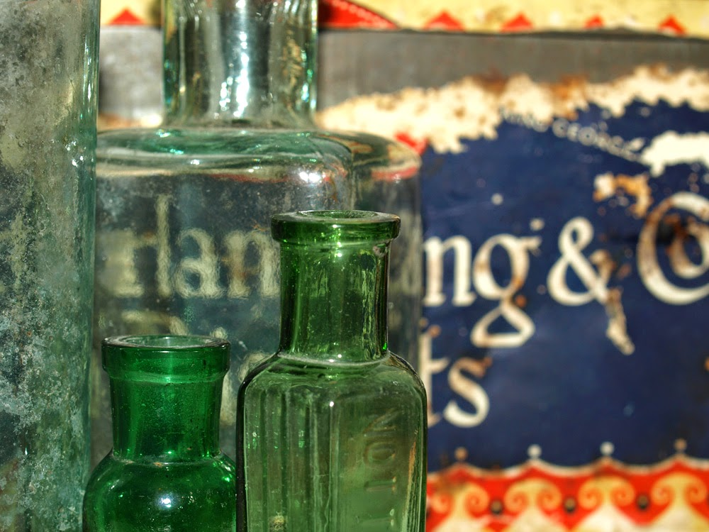 Green bottles and tin
