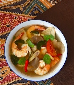 spicy tom yam koong soup with galangal, lemongrass, kaffir lime leaves, birds eye chili peppers