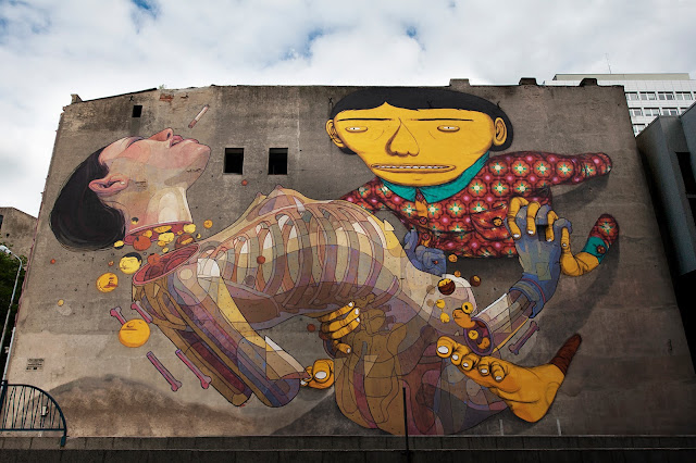 Street Art By Aryz And Os Gemeos in Lodz, Poland