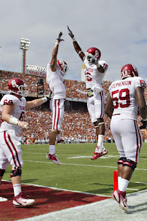 Kenny Stills #4 and Jaz Reynolds #16 of the Oklahoma Sooners celebrate after a touchdown against the Texas Longhorns at the Cotton Bowl on October 8, 2011 in Dallas, Texas. The Sooners defeated the Longhorns 55 to 17. (October 7, 2011 - Source: Wesley Hitt/Getty Images North America)
