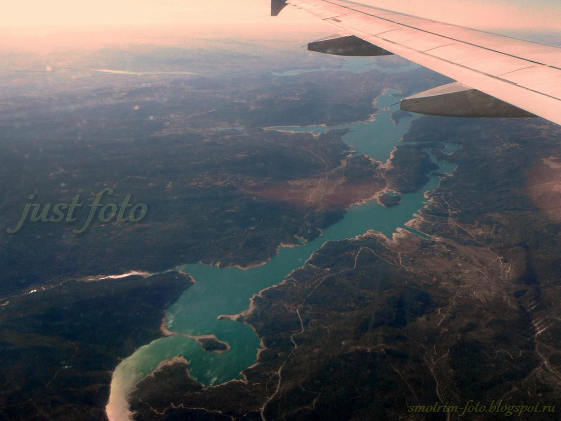 Пейзажи под крылом самолета