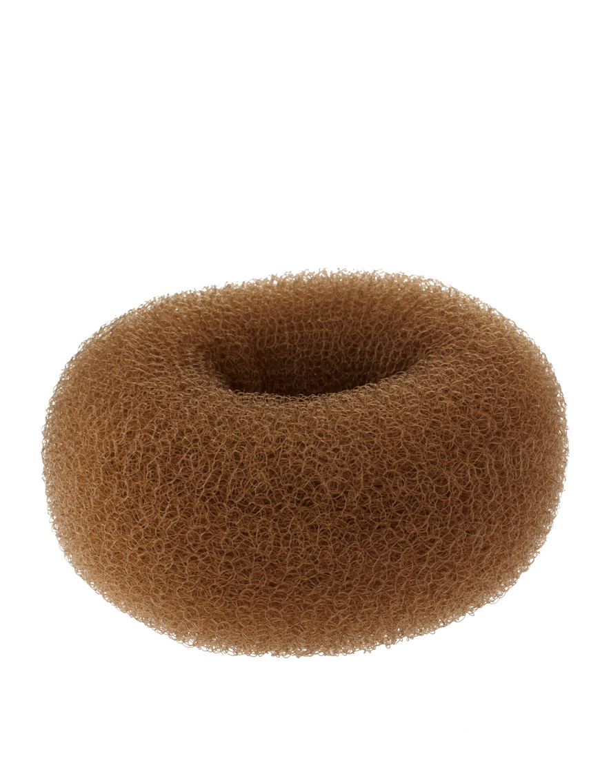 All you need is some kirbys, some hair spray and a hair doughnut (also known as a hair donut or sponge) which looks exactly as it sounds. They tend to come in a light yellow, brown & black, so you can pick one that roughly matches your hair.