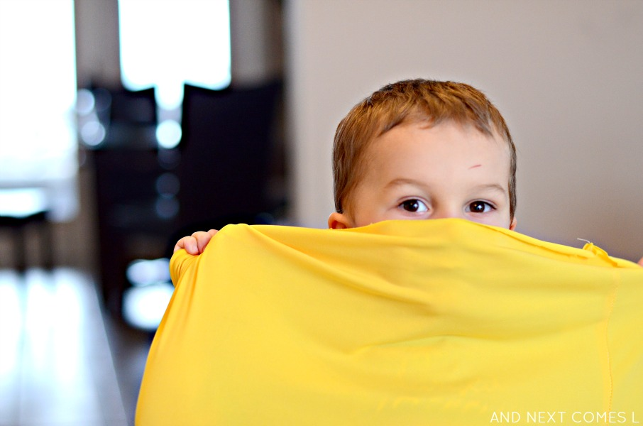 Playing peek-a-boo with a homemade sensory tunnel from And Next Comes L