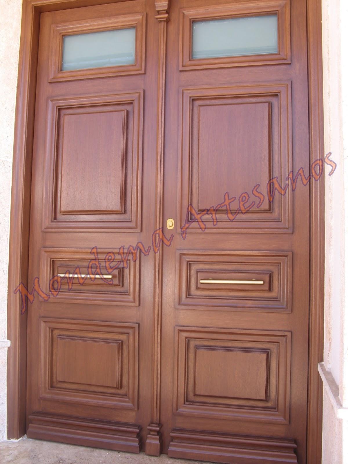 Puerta de calle de iroko artesanos carpinteros for Puertas de calle de madera