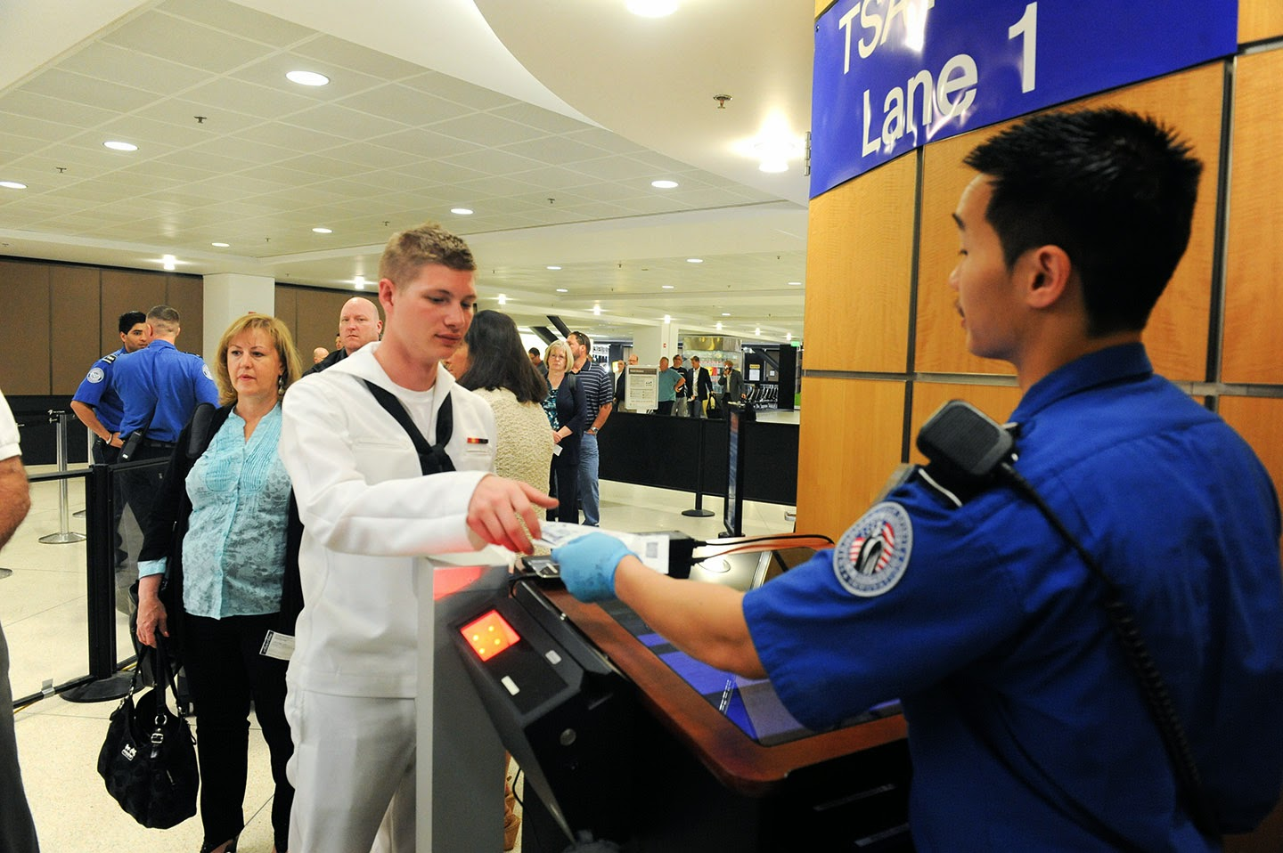 Sailor presenting boarding pass.