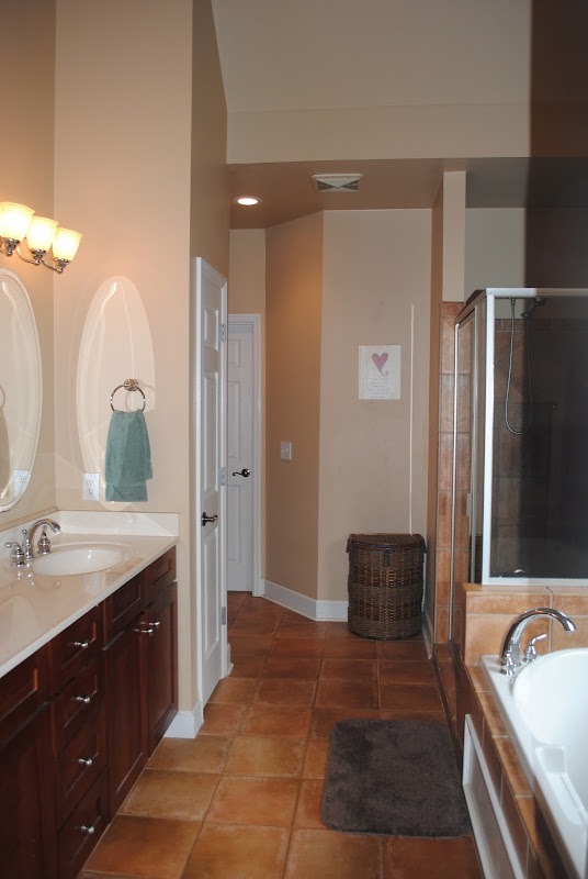 Master bath has double sinks, vaulted ceiling, a jetted garden tub and  title=