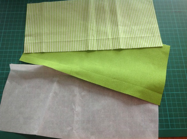 green plain and striped fabric and a piece of Bondaweb