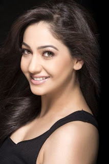 Pooja Warma Beautiful Brown Eyes Black Sleevelss Short dress Picture Shoot