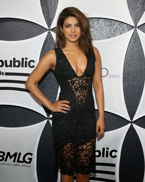 Priyanka Chopra Sexy Cleavage & thighs in Black See-through Dress at GRAMMY After Party