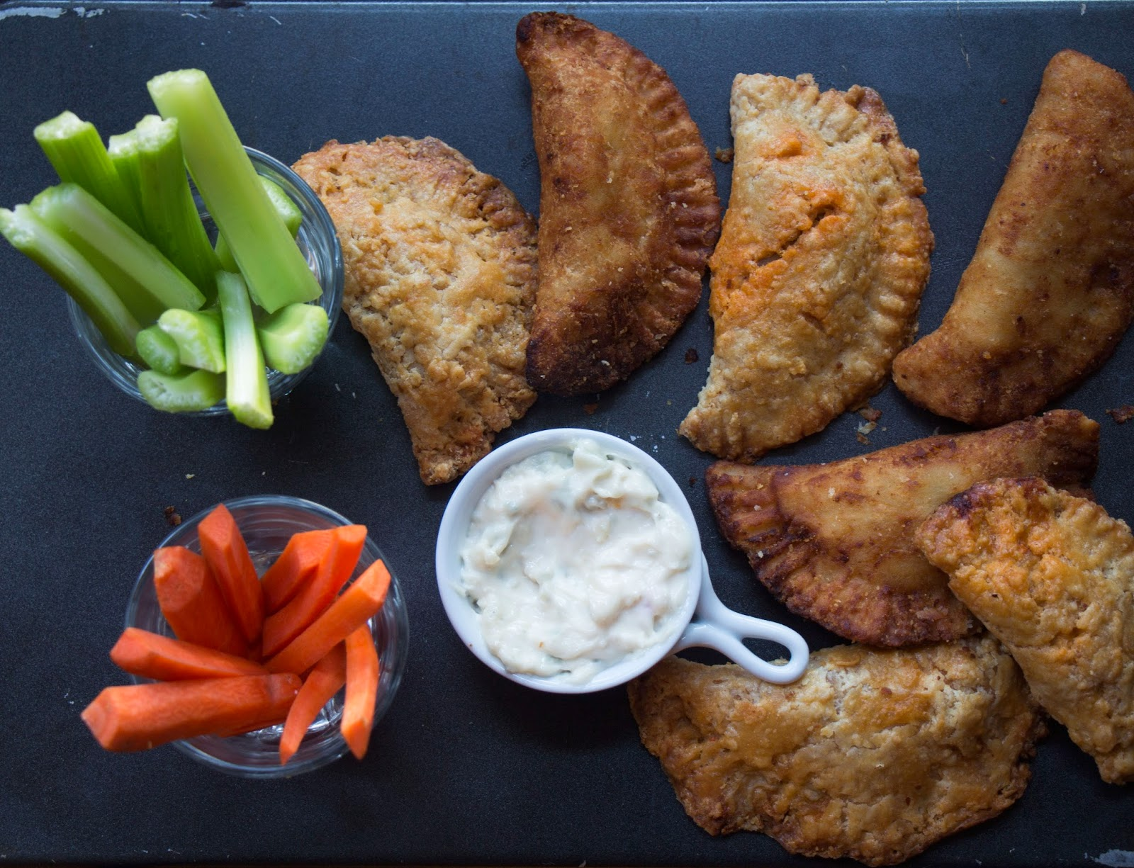 Buffalo Chicken Fried Pies with Celery and Carrot Sticks and Ranch Dressing