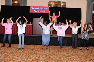 "photo of: Kentucky Head Start Conference Keynote with Debbie Clement: Participants Dancing to ""Piggy Rap"""