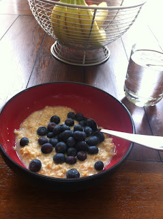 Breakfast Is Served: Oatmeal With A Generous Helping Of Blueberries And A  Glass Of Water. I Resisted The Urge To Drink Processed Juice.