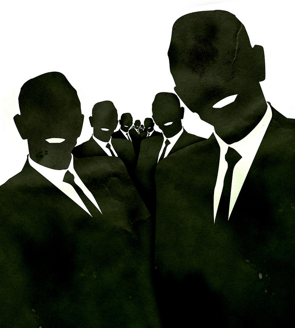 A group of identical smiling suited silhouettes