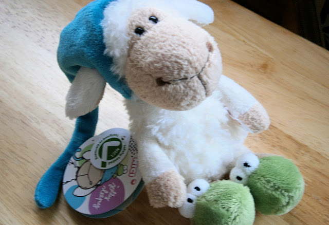 nici jolly sleepy sheep with green frog blue hat cuddly toy