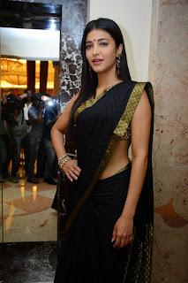 Shruthi Han in Beautiful Black Saree with Golden Jari work at Poojai Press Meet Spicy Pics