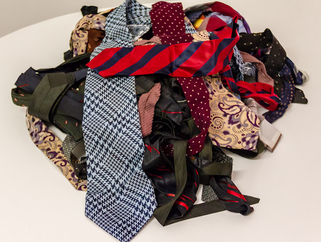 ties piled on table