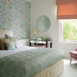 Padded plain bedhead and valance is given new life with a floral blue feature wall.