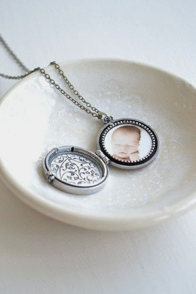 http://www.whitetrufflestudio.com/collections/mother-s-day-collection/products/monogram-photo-locket-necklace-style-503
