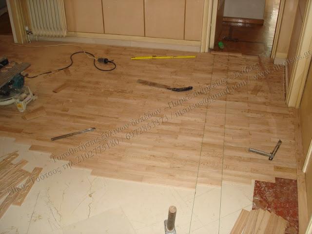 Κολλητό ξύλινο πάτωμα πάνω σε μάρμαρο