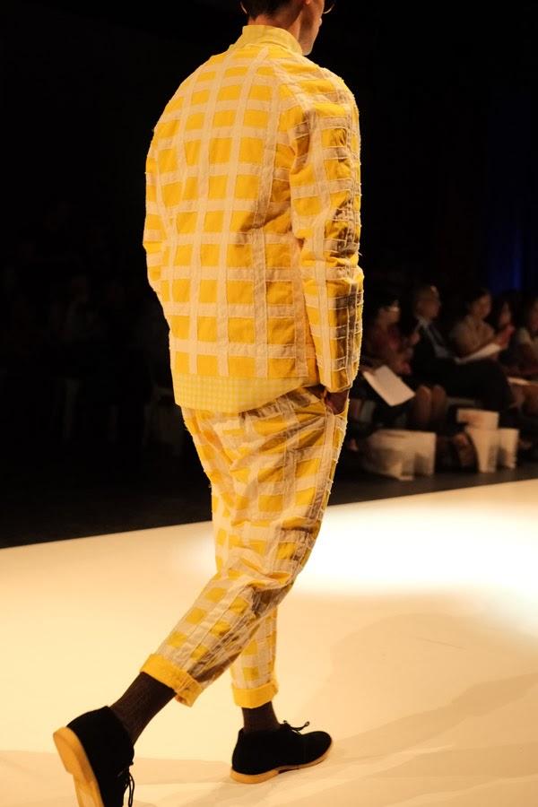 Matiny Ng; yellow and white large check pattern jacket and pants with large round pocket motif; rear view - Menswear : Raffles Graduate Fashion Parade 2013  Photography by Kent Johnson.