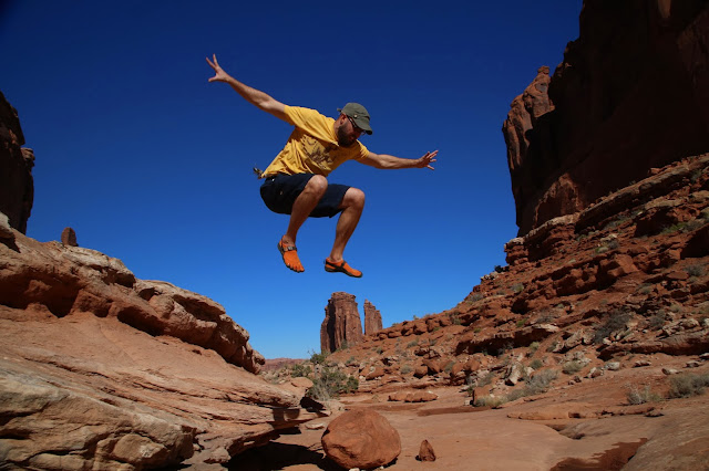 Jumping over a huge feature in Park Avenue at Arches National Park.