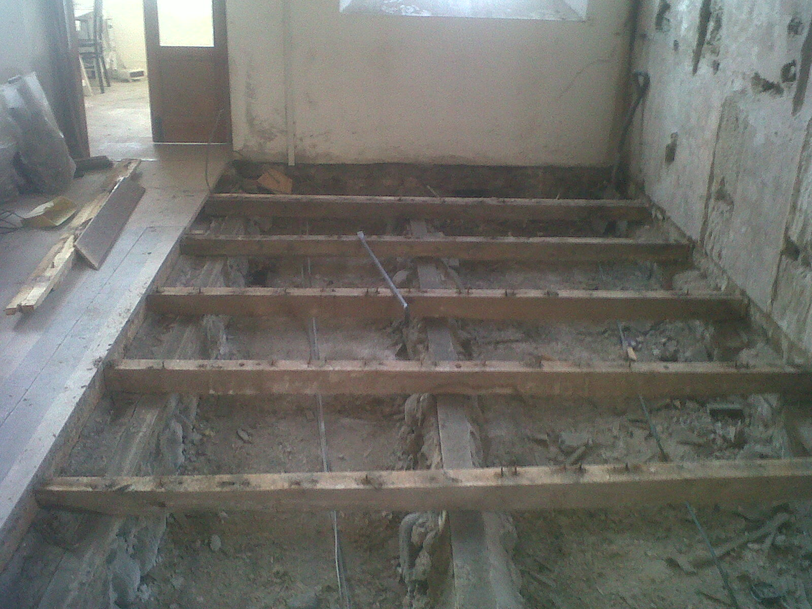 Amroth project taking the existing timber suspended floor up for Suspended concrete floor