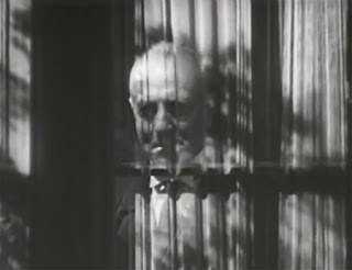 Evil Elwyn's face at the window (George Zucco)