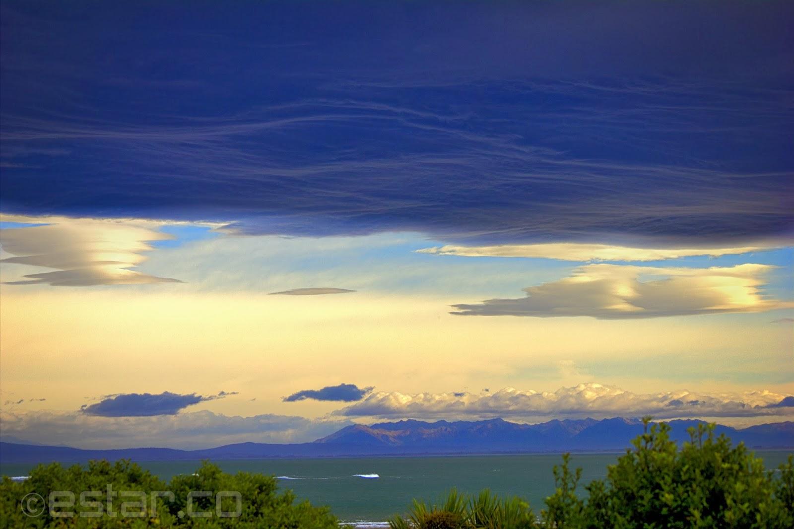 A Bruising Sky, photo of dark clouds over the ocean