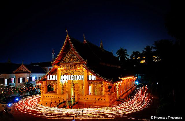 Long exposure of a low lit scene at Vat Ong Teu, Vientiane,   during the candlelit procession around the temple.  Photo Credit:  Phoonsab Thevongsa