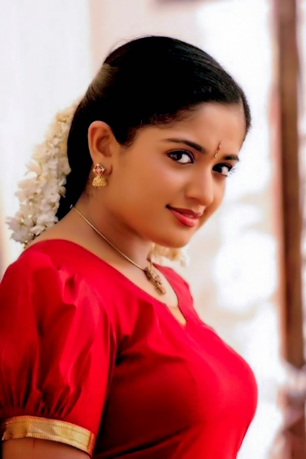 Malayalam actress Kavya Madhavan in red blouse