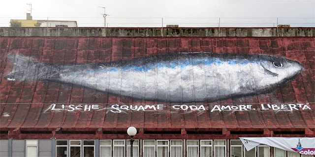 Big fish painted on the roof of the Fish Market by Libera Capezzone, Livorno