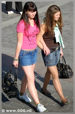 Girls in denim skirt on the street